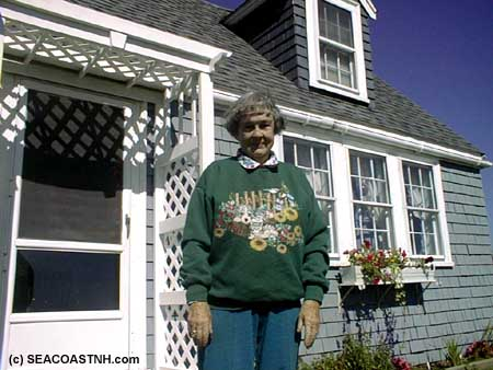 Prudy Randall outside Honeymoon Cottage on Luncing Island at the Isles of Shoals (c) J. Dennis Robinson / SeacoastNH.com
