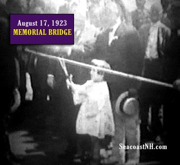 A 5-year old future mayor Eileen Dondero cuts the ribbon opening the new elevating Memorial Bridge in 1923.