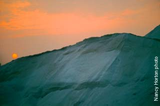 Sunset over salt piles / Nancy Horton