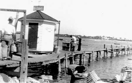 The old wharf, across Harbor Road from the Port of Missing Men, was the center of activity at the harbor prior to 1962. (William Varrell)