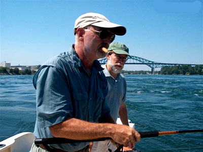 Rod Philbrick and JD Robinson fish the rapid waters of the Piscataqua River / NH Gazette Photo