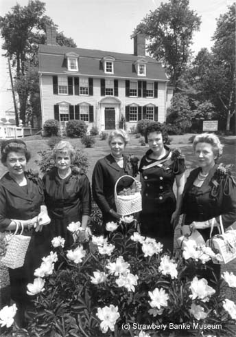Guild of Strawbery Banke in garden at Portsmouth Historical Society (John Paul JOnes House) in Portsmouth NH in the early 1960s/ Copyright Strawbery Banke Museum Collection