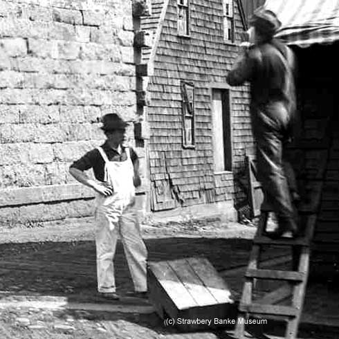 Two guys working at the Coal Store, Portsmouth, NH / Strawbery Banke Archive