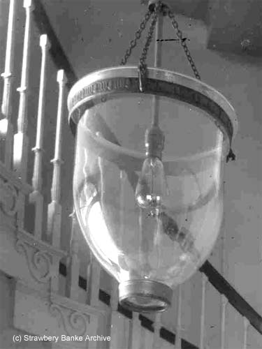 Detail of old Victorian era  lamp and bulb/ SeacoastNH.com