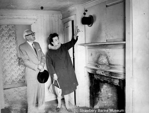 Jdson Dunaway of Dover and Dorothy Vaughan inspect the John Clark House before its renovation as the Captain Wheelwright House in the 1960s in Portsmouth, NH / Strawbery Banke Museum Collection