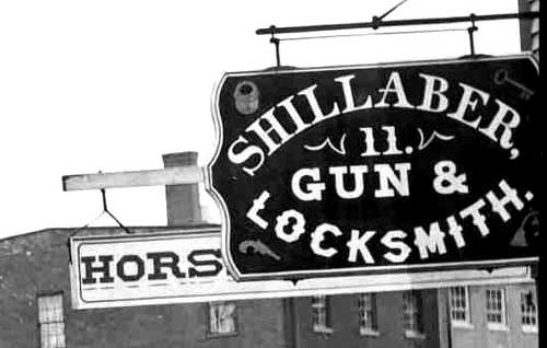 Signs on Bow Street, Shillaber Guns / Strawbery Banke Archive