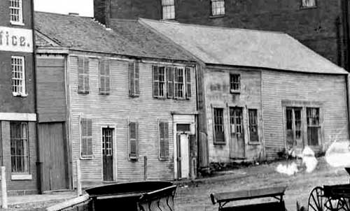 Wooden buildings no lionger standing on Bow Street, circa 1881 / Strawbery Banke Archive