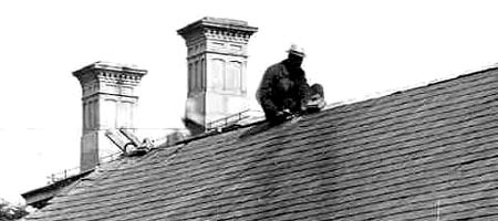 Worker on roof pre-1905 with Old POst Office behind him / Strawbery Banke Archive