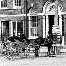Horsecart outside the Athenaeum in 1870 / Strawbery Banke Archive