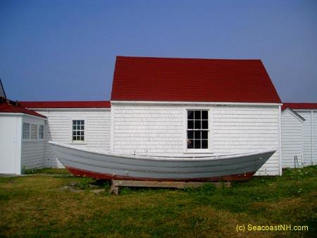 Boat and buildings at the Monhegan Museum / J. Dennis Robinson at SeacoastNH.com