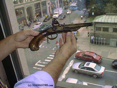 Holding Paul Jones pistol in Boston (c) SeacoastNH.com