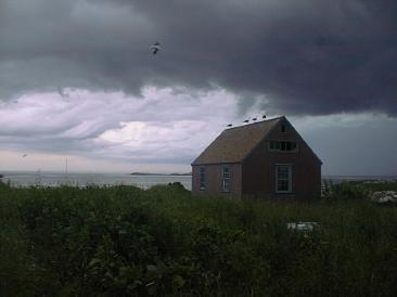Haley Cottage with an approaching STorm / SeacoastNH.com