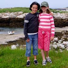Author Sarah (right) and companion Molly (left) pose in front of Smuttynose Cove on there second visit to the Isles of Shoals / SeacoastNH.com