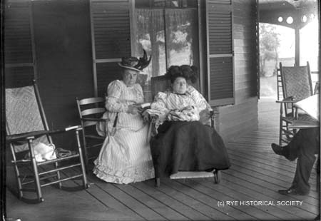 Unidentified ladies reading and napping on Farragut porch in Rye NH/ Rye Historical Society